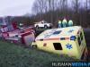 Brandweerauto-en-ambulance-in-sloot-door-gladheid-bij-Siddeburen